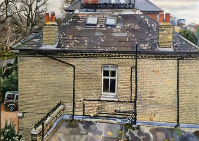 View of London brick house with grey roof tiles and cloudy sky