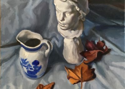 Still life with plaster bust, blue and white jug, and autumn leaves